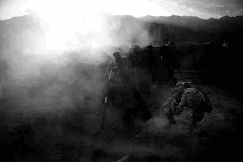 "PFC Darren Jaworski, right, with 2-27th infantry from Hawaii, part of ""Task Force No Fear"", covers his ears as a explosive round from 120mm mortar is fired at a suspected enemy fighting position on a area known as ""Rocket Ridge"" from Observation Post Mustang in Kunar Province, northeastern Afghanistan on September 4, 2011."