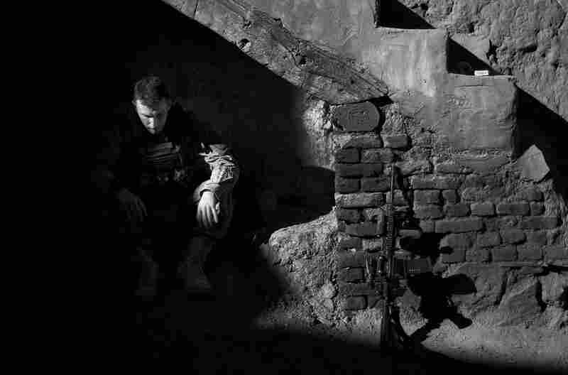 Lt. Paul Lankford takes a break under a stairway on the west side of the river in Charkh on April 22, 2011.