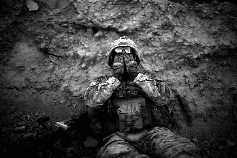 Lance Corporal Anthony Espinoza Bravo Co. 1/5 Marines, wipes the salt and sweat out of his eyes at the end of a day-long patrol out of Patrol Base Fires in Sangin District, Helmand province, southern Afghanistan on May 4, 2011.