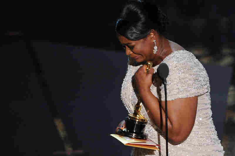 "Octavia Spencer tearfully accepts the award for Best Supporting Actress for her portrayal of Minny Jackson, a housemaid in 1960s Mississippi, in the film adaptation of Kathryn Stockett's ""The Help""."