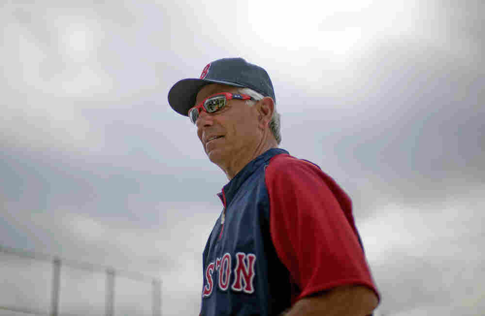 Boston Red Sox manager Bobby Valentine watches over batting practice during a baseball spring training workout on Sunday.