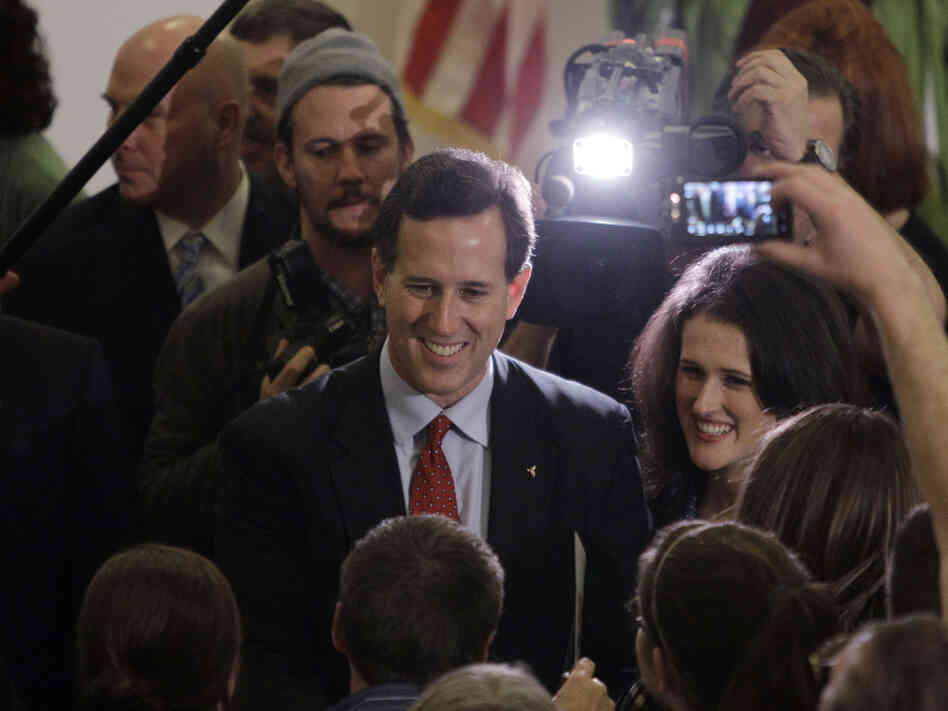 Rick Santorum and daughter, Elizabeth, greet supporters during a Davison, MI campaign rally.