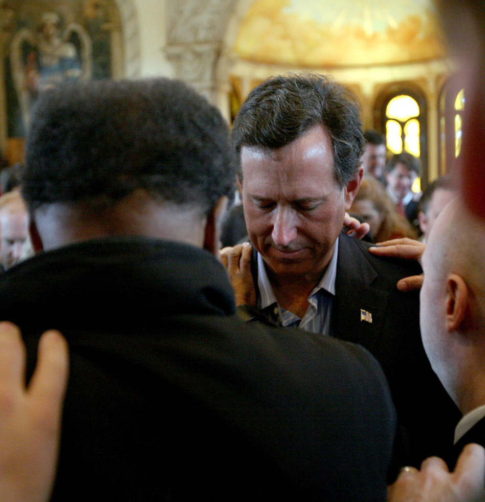 Republican presidential candidate Rick Santorum, center, and supporters as they prayed earlier this month in McKinney, Texas.  (Tom Pennington/Getty Images)