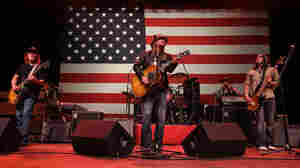 """Kid Rock performs during a campaign rally for Republican presidential candidate Mitt Romney in Michigan Monday night. Romney asked for, and was given, permission to use the Detroit rocker's song """"Born Free"""" in his campaign."""