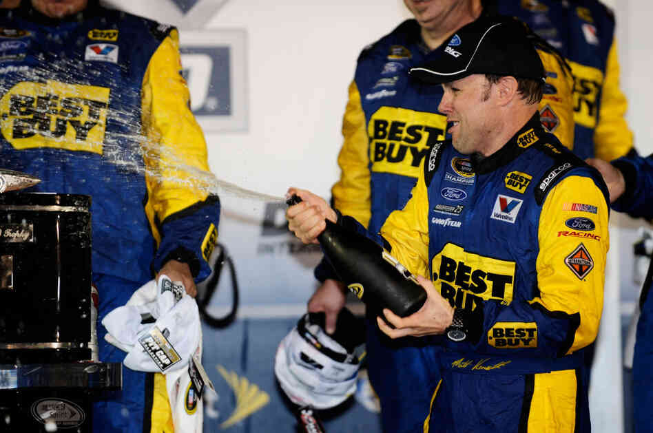 Matt Kenseth, driver of the #17 Best Buy Ford, celebrates in Victory Lane with champagne after winning the NASCAR Sprint Cup Series Daytona 500 at Daytona International Speedway on Tuesday.