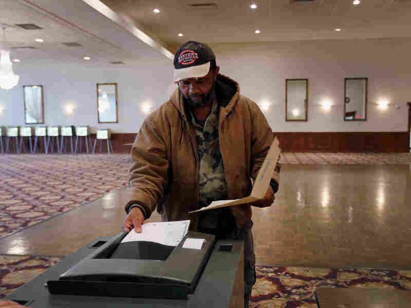 """Freddie Parker who said he is a Democrat casts his vote in the GOP primary as Michigan heads to the polls on Feb. 28, 2012 in Southfield, Michigan. """"Reagan Democrats,"""" typically conservative blue collar democrats, may have significant influence in the 2012 elections."""