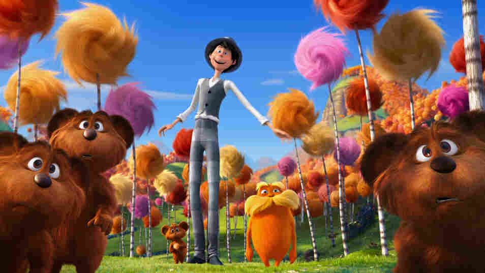 The Once-ler (voiced by Ed Helms) and the Lorax (Danny DeVito) are surrounded by bar-ba-loots in Truffula Valley in Dr. Seuss' The Lorax.
