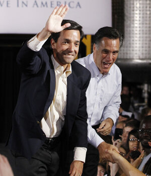 Mitt Romney campaigns with Puerto Rican Gov. Luis Fortuno at Lanco Paint Co. in Orlando, Fla., last month. The Puerto Rico's March 18 primary could be a significant s
