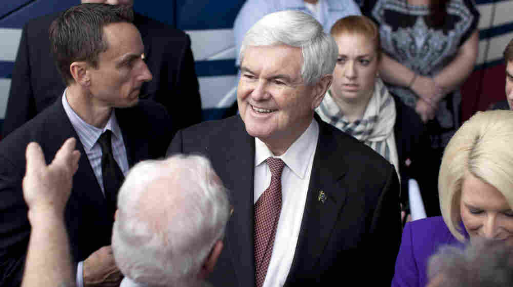 Newt Gingrich shakes hands during a campaign rally Tuesday in Rome, Ga.