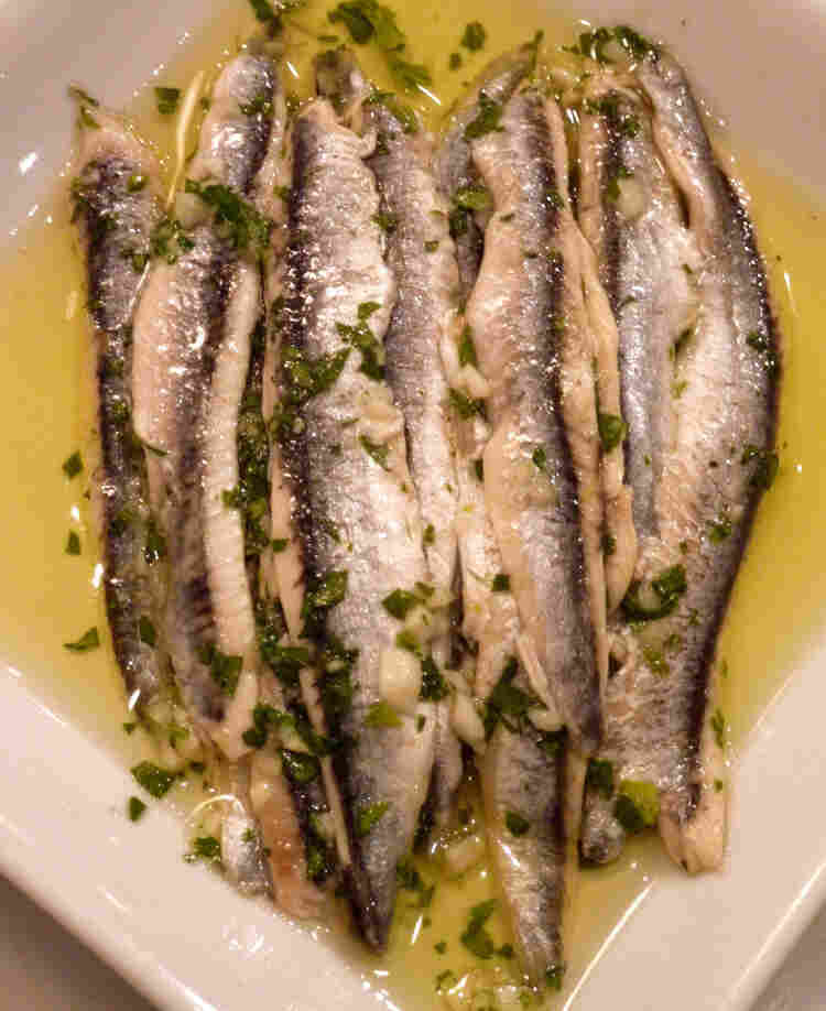 Boquerones, or vinegar-cured anchovies with garlic and parsley