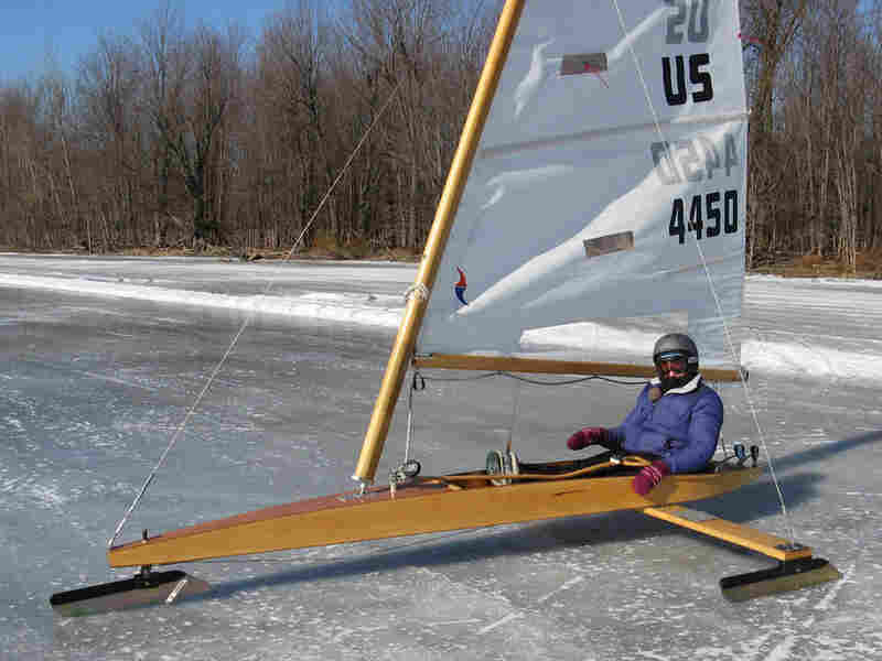 For her ride around the lake, reporter Sarah Harris claimed the ice boat's only seat while Sajor balanced the plank next to her. Together, they reached a top speed of about 48 miles an hour.