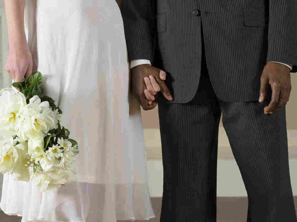 Americans are marrying outside of their race or ethnicity at record levels.  In our second hour, callers in interracial marriages talk about their families' reaction.