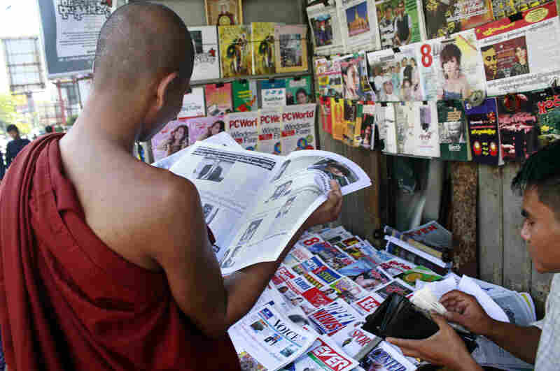 A Buddhist monk reads a newspaper in Yangon on Tuesday. Newspaper articles that would have been rejected by Myanmar's draconian state censors just months ago are making it into print, in one of many signs that the long-repressed country is becoming more open.