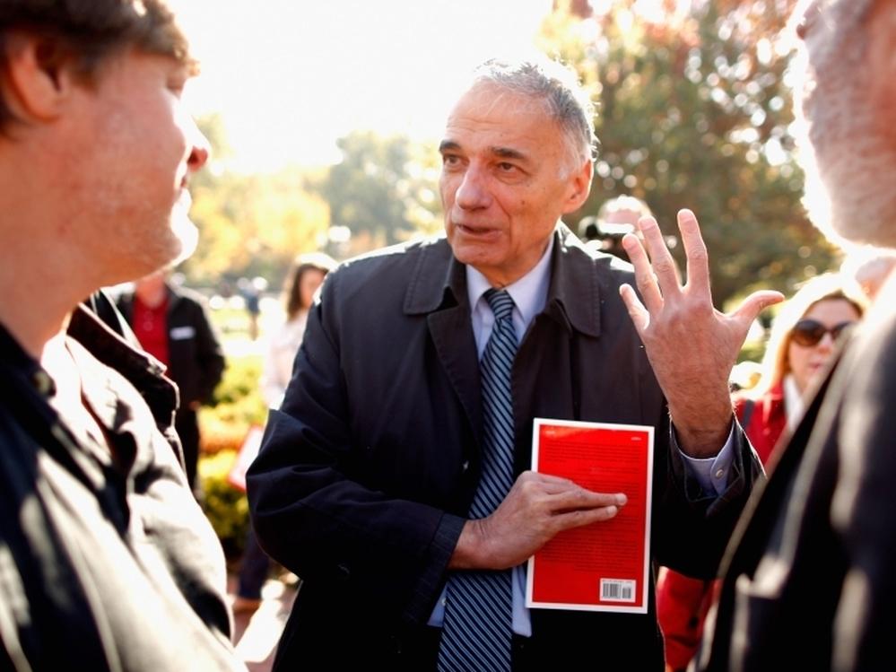 ... talks with labor leaders at a rally Washington, D.C., on Nov. 3, 2011.