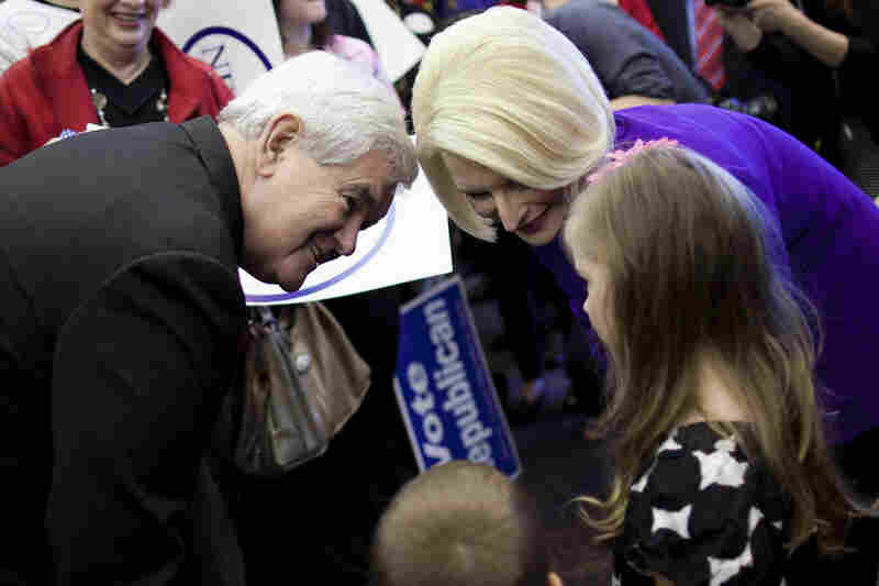 """Gingrich and wife Callista meet Kaylan Cape, 5, in Dalton. The former Georgia congressman said Tuesday that he """"unequivocally"""" has to win there."""