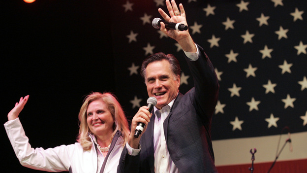 In a final bit of campaigning before Tuesday's vote, Mitt Romney and his wife, Ann, wave to his supporters during a campaign stop in Royal Oak, Mich., on Monday night.  (Reuters /Landov)