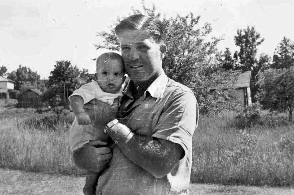 "George Romney holds infant Willard ""Mitt"" Romney, the youngest of his four children, in this 1947 family photo."