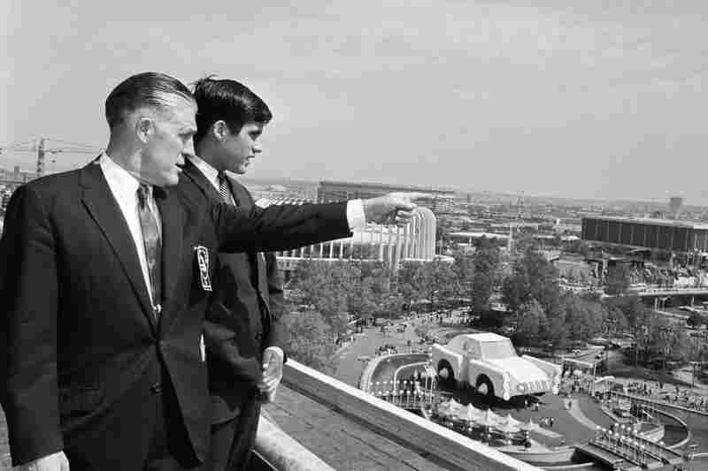George and Mitt Romney look out over the grounds of the World's Fair in 1964. The World's Fair included exhibits from several automobile companies.