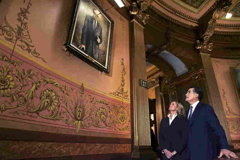 Mitt Romney and his wife, Ann, look up at a portrait of his late father at the Capitol rotunda in Lansing, Mich., in 2008.