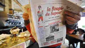 "A man reads a copy of the satirical newspaper La Bougie du Sapeur (The Sapper's Candle), published every leap day, in a Parisian cafe on Feb. 29, 2008. The paper's tagline is ""without reproach."""