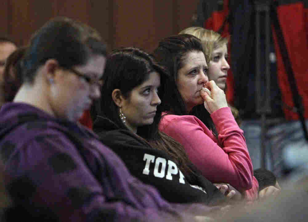 Community members attend a  a prayer service for victims of a school shooting at Chardon Assembly of God in Chardon, Ohio on Monday.