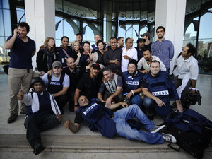 Journalists freed from Rixos Hotel pose for a picture upon their arrival to Corinthia Hotel in the Libyan capital Tripoli on August 24, 2011. Some 30 journalists had been held against their will in Tripoli's Rixos Hotel by guards loyal to Libya's former leader, Moammar Gadhafi.