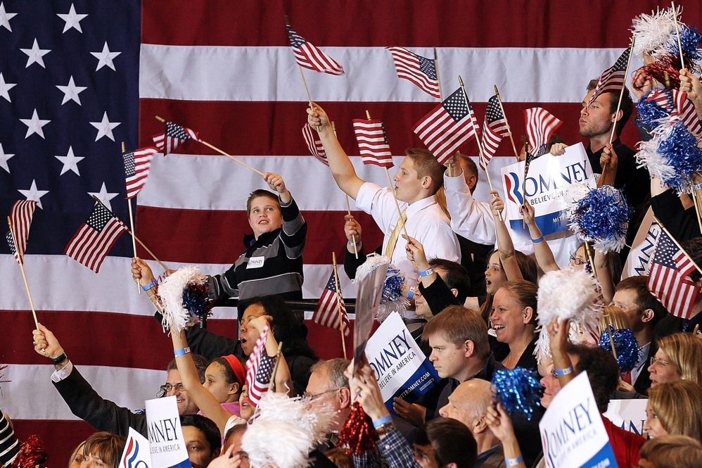 Romney supporters cheer during a primary night gathering at the Suburban Collections Showplace in Novi, Mich.