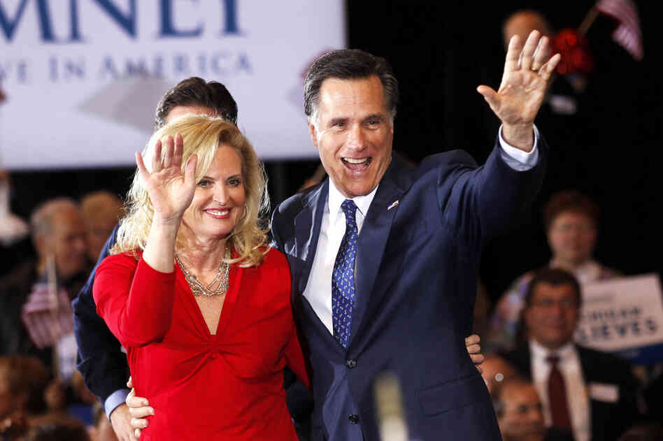Detroit native Mitt Romney greets supporters with wife Ann in Novi, Mich., after squeaking out a win in Tuesday's primary. He also won Arizona.