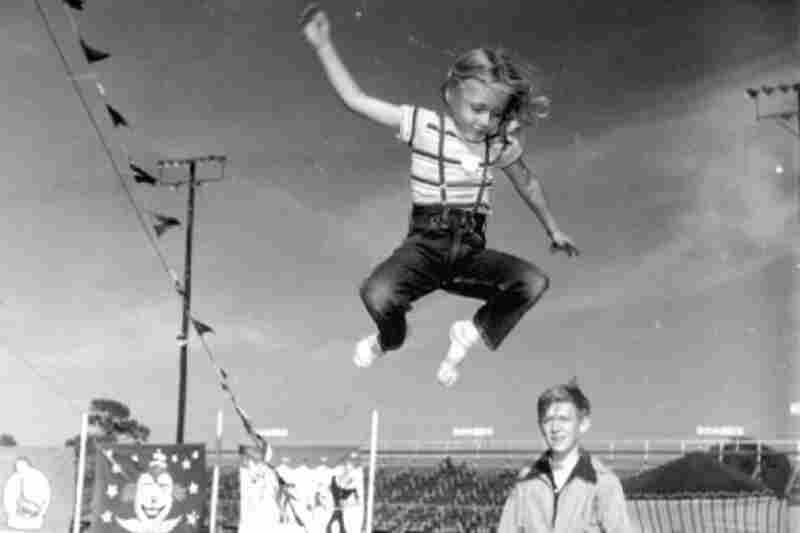 Girl on a circus trampoline, 1952