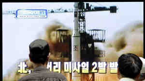 South Koreans watch a television broadcasting undated image a North Korea launch missile at the Seoul Railway Station in Seoul. This is a file photo from July 2009.