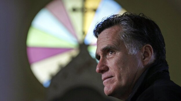 Republican presidential candidate Mitt Romney pauses during a visit to St. Paul's Lutheran Church while campaigning in Berlin, N.H., on Dec. 22.