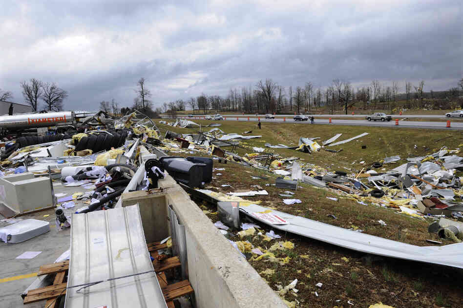 Debris is scattered near Harry Owen Trucking in Elizabethtown, Ky.