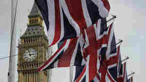British Union Jack flags flutter in the wind next to Big Ben, in London, on April 28, 2011.