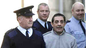 Essam Eid is led into Dublin, Ireland's Four Courts in 2008.