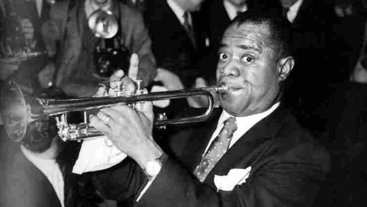 Louis 'Satchmo' Armstrong, the great jazz trumpeter and vocalist playing at the Savoy Hotel, London.