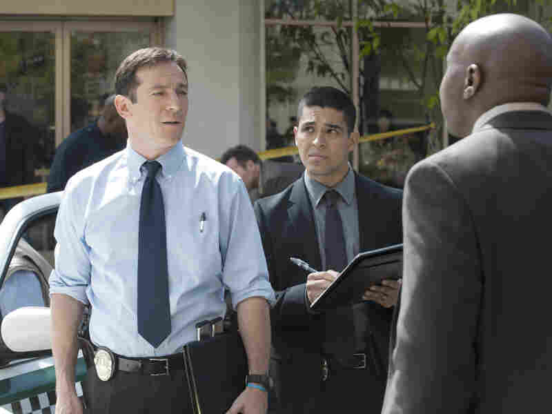 """Michael Britten (Jason Isaacs) continues to work police cases after his accident with his colleagues Detective Efrem Vega (Wilmer Valderrama) and Detective Isaiah """"Bird"""" Freeman (Steve Harris)."""