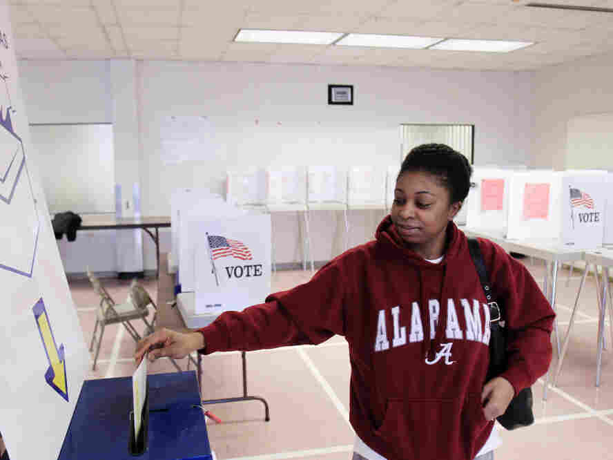 As the candidates head into Super Tuesday on March 6, Ohio is shaping up as the biggest prize. Sheenae Westmoreland drops her ballot into the box after early voting in Cleveland on Jan. 31.