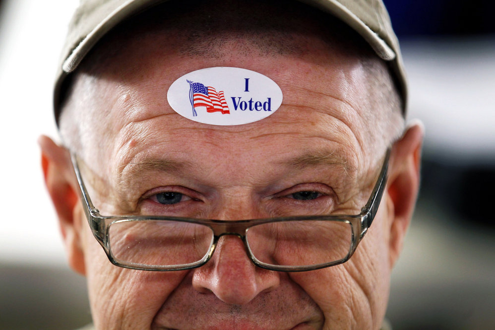 """John Vandermark wears an """"I Voted"""" sticker after voting in the Michigan primary at Royal Oak Farmers Market, in Royal Oak."""
