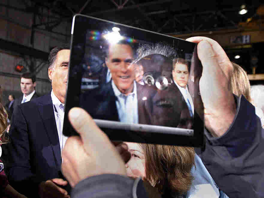 Mitt Romney was captured on the iPad screen held by a man at a campaign event in Toledo, Ohio, on Wednesday.