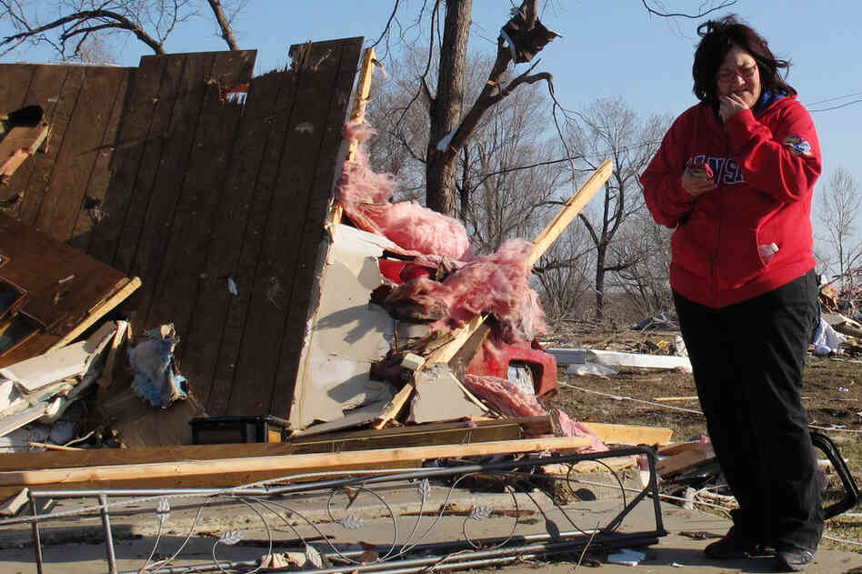 Tammy Woodyard surveys the wreckage of her father's home in Harveyville, Kan.