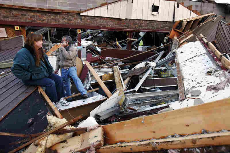 The storms, which spawned at least one tornado, destroyed Sherry Cousins and her brother Bruce Wallace's secondhand store in Branson, Mo.