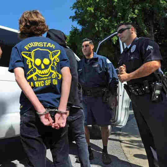 Los Angeles Police Department officers detain students in 2010 during a sweep for truants in the San Pedro neighborhood.