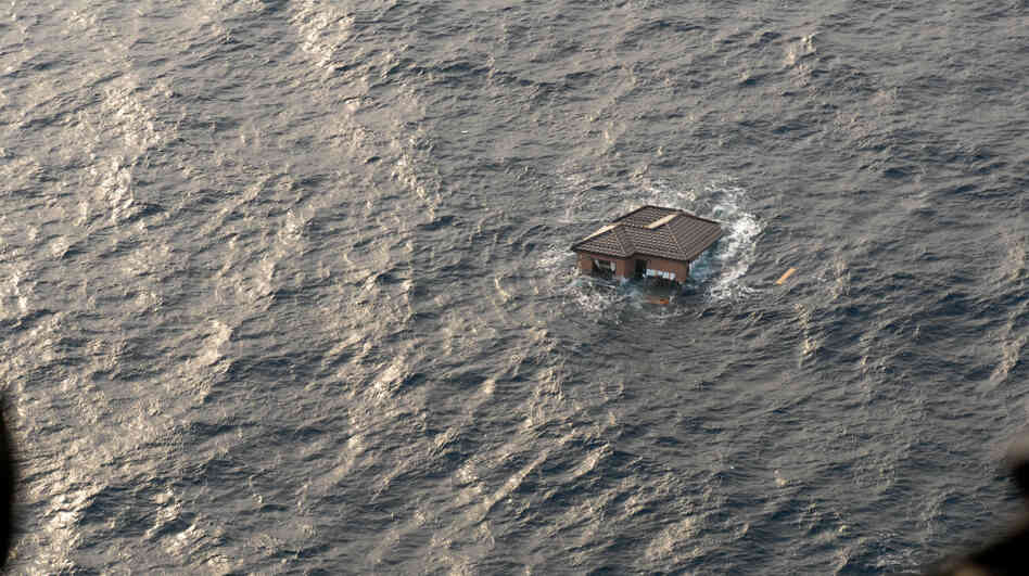 A Japanese home drifts in the Pacific Ocean, two days after the Japanese earthquake and tsunami. Photo provided by the U.S. Navy.