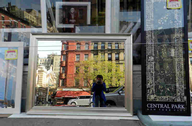 Stephen Boyd, 12: I took this picture in New York city.  I like that the mirror in the storefront reflects the buildings and the street and me taking the picture!