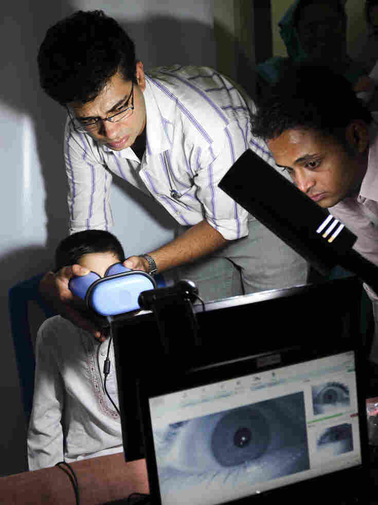 An Indian boy gets his eyes scanned for enrollment in a nationwide ID project in 2011. Many Indians, especially the poor, lack identification documents, which restricts their access to many government services.