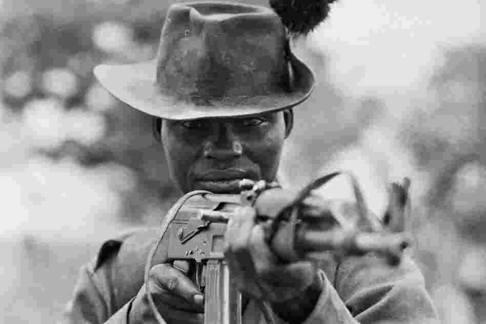A Sudanese fighter holds his AK-47 at the ready in 1971. The gun's simple, intuitive design has made it popular among small-arms dealers, as well as insurgents, terrorists and child soldiers.