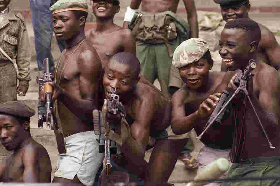 Young rebels in Zaire, now called the Democratic Republic of Congo, play with their AK-47s in the city of Goma in 1996.