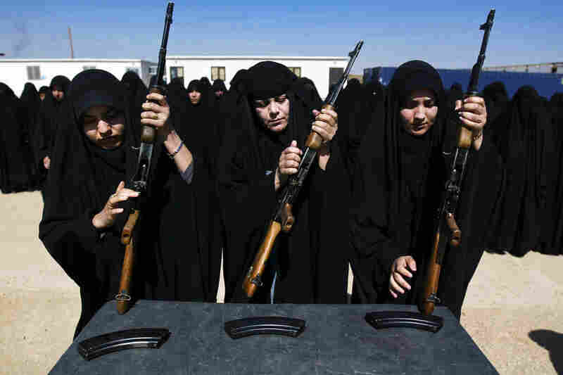 Iraqi police cadets are trained to use AK-47s in Karbala, Iraq, on March 26, 2009.