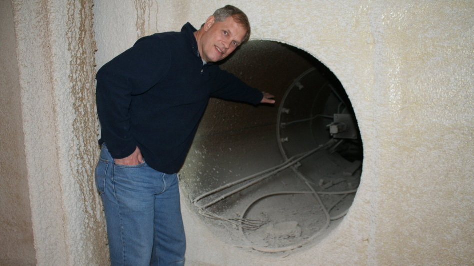 Larry Hall shows off the old vents and 9-foot-thick walls of a missile silo he's developing into condominiums.  (Frank Morris)