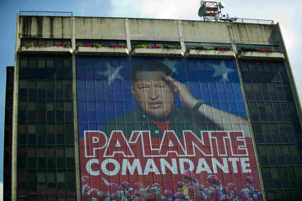 "A huge photograph of Venezuelan President Hugo Chavez is displayed on the facade of state-owned oil company PDVSA (Petroleos de Venezuela) in Caracas on Wednesday. The text reads, ""Move forward, commander."""